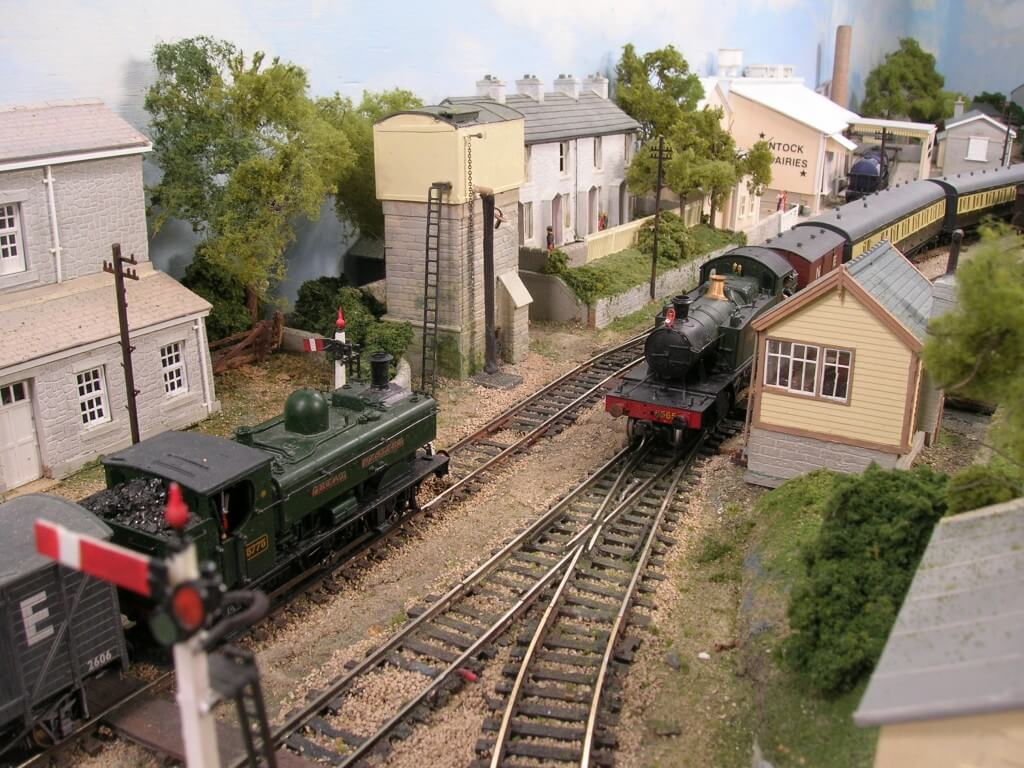 Prairie and pannier between model railway Water Tower and Signal Box.